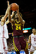 Forward Eric Curry (24) goes up for a contested basket during the first half of the University of Minnesota Men's Basketball game versus University of Wisconsin on March 5, 2017.