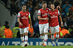 LONDON, ENGLAND - Oct 01: Arsenal's midfielder Mikel Arteta from Spain Arsenal's forward Olivier Giroud from France   and Arsenal's midfielder Mesut Ozil from Germany  celebrate a goal during the UEFA Champions League match between Arsenal from England and Napoli from Italy played at The Emirates Stadium, on October 01, 2013 in London, England. (Photo by Mitchell Gunn/ESPA)