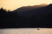Sun sets over Laek Crescent. Olympic National Park, Washington