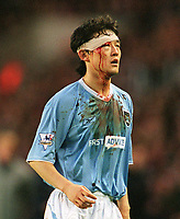 Jihai Sun (City) battles on with a cut to his head. Southampton v Manchester City. 1/11/2003. Credit : Colorsport/Andrew Cowie.
