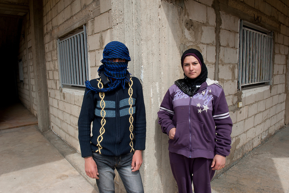 A Brother and a sister with opposite opinions: she supports the revolution, he is for the  Bachar regime. Both are refugees who arrived on March 10 in the village El Fakha, Lebanon, after fleeing violence and heavy shelling in Zahra (Syria).