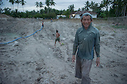 Abong (52 years) after a long day of labour in the middle of the devastated landscape his mining activity created. He has been a miner since more then 20 years. He considers mining as a very dangerous job but he needs the money for a decent living. Bangka Island (Indonesia) is devastated by a deadly tin rush, a direct consequence of the success of smartphones and tablets like iPhones and iPads from Apple or Samsung. The demand for tin has increased due to its use in smart phones and tablets.<br /> <br /> Abong (52 ans) après une longue journée de travail au milieu d'un paysage dévasté par activité minière. Il a été mineur depuis plus de 20 ans. Il considère l'exploitation minière comme un travail très dangereux, mais il a besoin d'argent pour une vie décente. L'île de Bangka (Indonésie) est dévastée par des mines d'étain sauvages, une conséquence directe du succès des smartphones et tablettes comme les iPhones et les iPads d'Apple ou Samsung. La demande de l'étain a explosé à cause de son utilisation dans les smartphones et tablettes.
