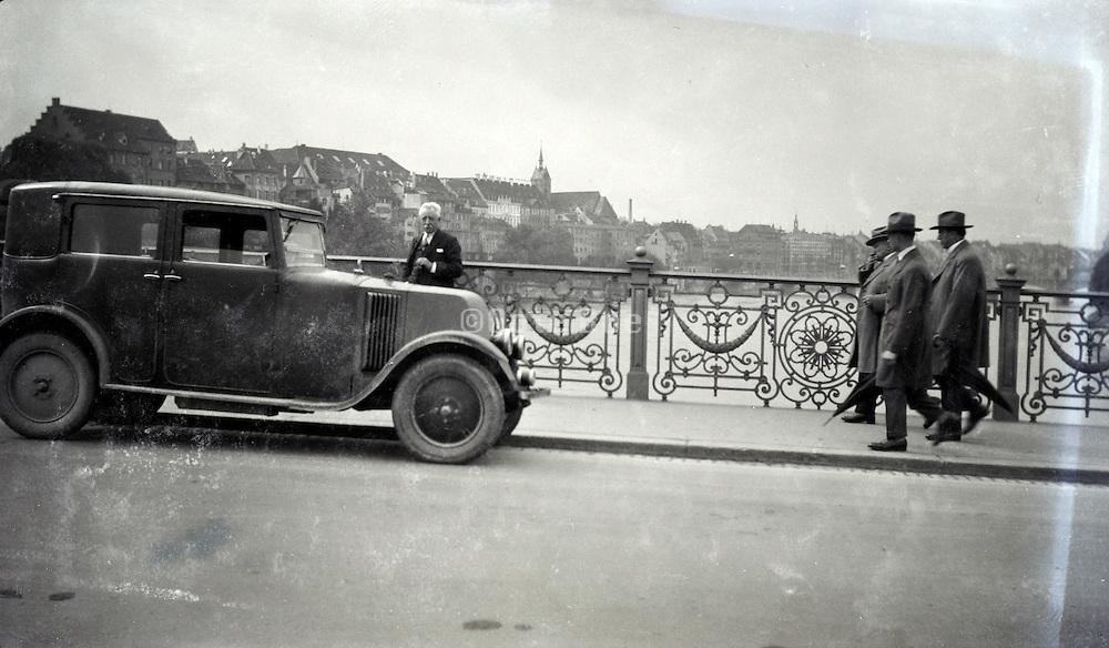 a Renault car parked on a bridge 1920s