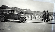 a Renault car parked on a bridge 1920s