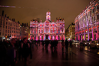 LYON, FRANCE - DECEMBER 04: For four nights over 70 light installations will create a magical atmosphere in the streets, squares and parks all over the city and millions of visitors both French and from abroad will enjoy the friendly and joyful spirit of this unique event on December 4, 2014 in Lyon, France. (Photo by Bruno Vigneron/Getty Images)<br /> Lyon, Land of Enlightenment<br /> Place des Terreaux , Lyon 1<br /> Artists: Gilbert Coudène - Etienne Guiol - Ecohlcité<br /> Masterpieces from the Museum of Fine Arts will be displayed on the building facades. The figures depicted in these masterworks escape from the frame and are joined by performers from the Opera, followed by other dancers and musicians. This joyful, fairytale ballet with images and video projections created, respectively, by BK and Studio Theoriz, reaches an apotheosis in a sparkling shower of candles.<br /> Opening hoursFriday 5th and Saturday 6th: from 6 p.m to 1 a.mSunday 7th: from 5:30 p.m to midnightMonday 8th: from 6 p.m to midnight<br /> Metro Line A/C - Hôtel de Ville-Louis Pradel stop