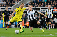 Burton Albion striker Luke Varney (19) has a shot whilst Newcastle United midfielder Matt Ritchie (11) attempts to make a tackle during the EFL Sky Bet Championship match between Newcastle United and Burton Albion at St. James's Park, Newcastle, England on 5 April 2017. Photo by Richard Holmes.