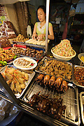 Hom Market. Barbecues quails, deep-fried shrimp etc. at a food stall.