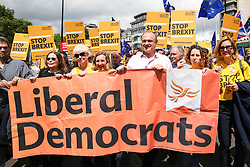 "© Licensed to London News Pictures. 20/07/2019. London, UK. Liberal Democrat leadership contender ED DAVEY (C) joins the Pro EU demonstrators during the ""No to Boris. Yes to Europe"" march in central London. Photo credit: Dinendra Haria/LNP"