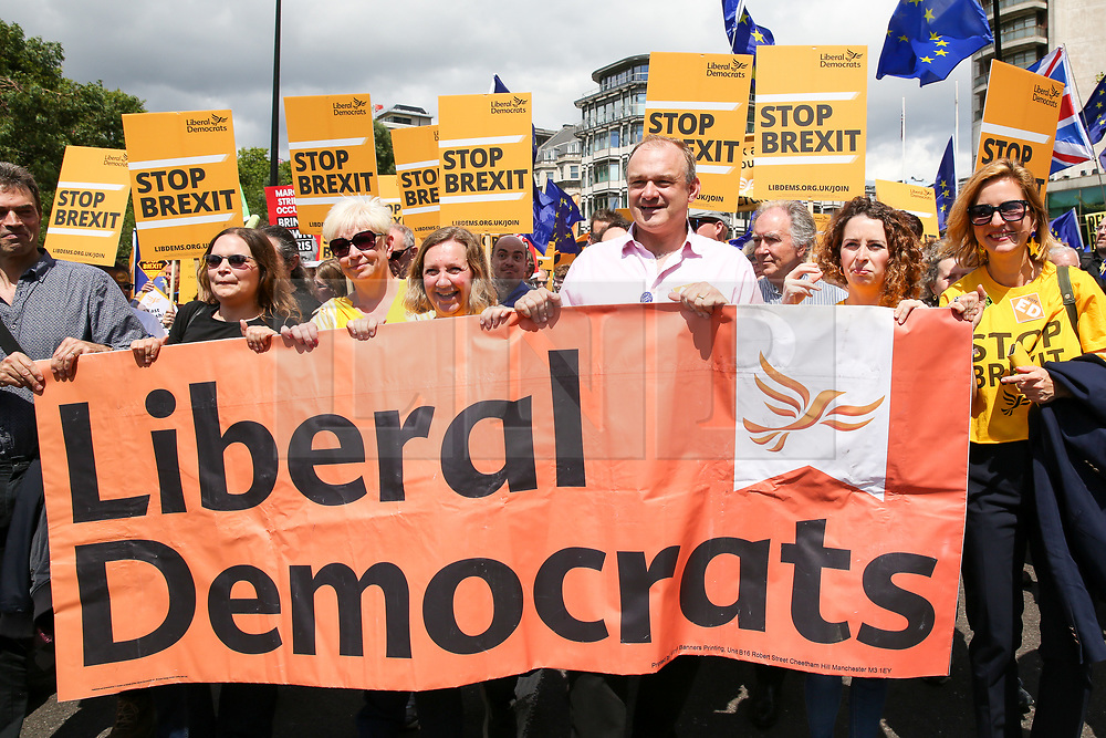 """© Licensed to London News Pictures. 20/07/2019. London, UK. Liberal Democrat leadership contender ED DAVEY (C) joins the Pro EU demonstrators during the """"No to Boris. Yes to Europe"""" march in central London. Photo credit: Dinendra Haria/LNP"""