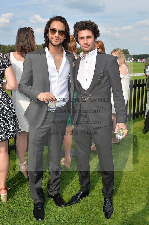 Left to right, PETER POLI and LUKE PASQUALINO at the Audi International Polo at Guards Polo Club, Windsor Great Park, Egham, Surrey on 26th July 2014.