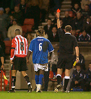 Photo. Glyn Thomas.<br /> Sunderland v Birmingham. FA Cup fifth round.<br /> Stadium of Light, Sunderland. 14/02/2004.<br /> Birmingham's Aliou Cisse (C) receives his marching orders for a second yellow card offence.