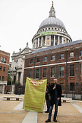 Activists from Africans Rising UK and other groups launch the Jubilee for Climate Campaign in Paternoster Square after a banner is dropped from St Pauls Cathedral on the anniversary of the assassination of the Pan-Africanist President of Burkina Faso Thomas Sankara on 15th October 2021 in London, United Kingdom. The Jubilee for Climate Campaign is an umbrella campaign both for the cancellation of debts for which Sankara fought so hard as well as for progressive and unifying policies to tackle the climate crisis which amplify voices from the Global South.