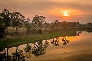 Sunset over the Brahmaputra river, Unesco world heritage site, Kaziranga National Park, Assam, India