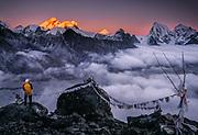 Trekker watches sunset on Chomolungma, Mt Everest & Makalu from Gokyo Ri, Khumbu Himal, Nepal Himalaya. Khumbu Himal, Nepal Himalaya.