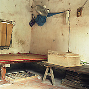 Interior of a house in Duong O paper making village, Bac Ninh province, Vietnam. With Vietnam's growing population making less land available for farmers to work, families unable to sustain themselves are turning to the creation of various products in rural areas.  These 'craft' villages specialise in a single product or activity, anything from palm leaf hats to incense sticks, or from noodle making to snake-catching. Some of these 'craft' villages date back hundreds of years, whilst others are a more recent response to enable rural farmers to earn much needed extra income.