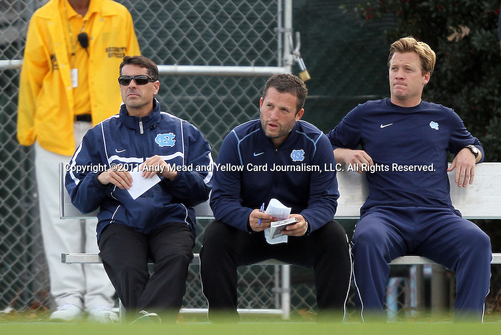 27 November 2011: UNC head coach Carlos Somoano (left) assistant coaches Jeff Negalha and Grant Porter. The University of North Carolina Tar Heels defeated the Indiana University Hoosiers 1-0 in overtime at Fetzer Field in Chapel Hill, North Carolina in an NCAA Men's Soccer Tournament third round game.