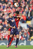 Football - 2019 / 2020 Premier League - Liverpool vs. AFC Bournemouth<br /> <br /> Liverpool's Joe Gomez battles with Bournemouth's Callum Wilson, at Anfield.<br /> <br /> <br /> COLORSPORT/TERRY DONNELLY