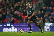 Vincent Kompany of Manchester City in action.Premier league match, Stoke City v Manchester City at the Bet365 Stadium in Stoke on Trent, Staffs on Monday12th March 2018.<br /> pic by Andrew Orchard, Andrew Orchard sports photography.