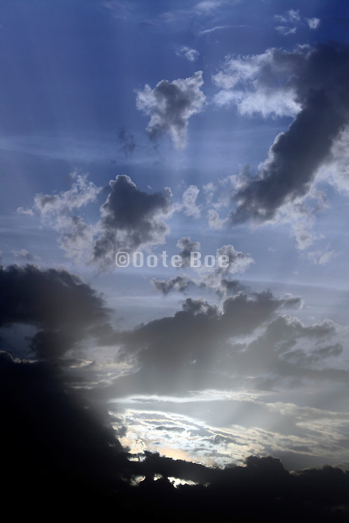 rays of sunlight with clouds