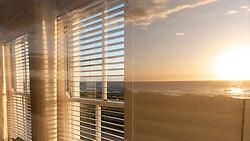 Reflection of Sunset on Beach on Window Pane, Hermanus, South Africa