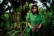 Victoria Kubirinketu, an Ashaninka woman, walks back to her village after collecting bananas and a banana flower (in her hands). <br /> With encroachment from settlers and speculators, and after a devastating war against Shining Path rebels a decade ago, the indigenous Ashaninkas' hold is precarious. And they are now facing a new peril, the proposed 2,200-megawatt Pakitzapango hydroelectric dam, which would flood much of the Ene River valley. The project is part of a proposal for as many as five dams that under a 2010 energy agreement would generate more than 6,500 megawatts, primarily for export to neighboring Brazil. The dams would displace thousands of people in the process. April 2012. Photo/Tomas Munita