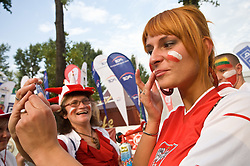 Painting the flag on the skin outside the arena at the EuroBasket 2009, on September 16, 2009, before Arena Lodz, Hala Sportowa, Lodz, Poland.  (Photo by Vid Ponikvar / Sportida)