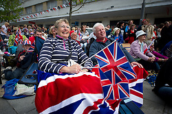 Plymouth, UK  29/04/2011. The Royal Wedding of HRH Prince William to Kate Middleton. A couple enjoy the Royal Wedding on the big screen in Plymouth city centre. Photo credit should read London News Pictures.