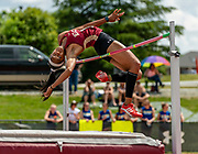 Elon University junior Melody Burke competes in the high jump during the CAA Track & Field Championship hosted by Elon University on May 4, 2019.