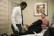 """BIRMINGHAM, AL – FEBRUARY 1, 2019:  Warren """"Azad"""" Stoddard, 24, receives medical treatment for a gunshot wound he suffered while fighting ISIS alongside Kurdish YPG forces in Syria. CREDIT: Bob Miller for The New York Times<br /> <br /> In the war against ISIS, American volunteers have joined the ranks of a Syrian militia, operating independently of the United States. Until recently, the predominantly Kurdish YPG forces had enjoyed air and ground support from the United States, but now that US is officially leaving, the remaining American volunteers face uncertain odds. <br /> <br /> Warren Stoddard, 24, comes from a long line of military veterans and active service members. So when a knee injury prevented him from enlisting in the Marines in 2016, he reached out to a YPG liaison on Facebook to declare his interest in volunteering. """"I always wanted to serve, to do something worthwhile and to take part in some historical event,"""" Stoddard said. """"And I cared about the Kurdish cause."""" Two years later, as the Turkish invasion placed added pressure on the predominantly Kurdish YPG, Stoddard finally received an invitation to join and purchased his own one way ticket. Six months later, while engaging an ISIS stronghold alongside his YPG unit, Stoddard caught bullet fragments in his his upper thigh and foot, where a small fragment is still lodged."""