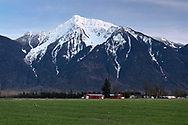 Agassiz Farmland with Mount Cheam (Lhílheqey) in the background. Mount Cheam is a prominent mountain peak in the Fraser Valley of British Columbia. Located in the Canadian Cascade Range, the peak reaches 2104 meters/ 6903 feet in elevation.   Photographed from Agassiz, British Columbia, Canada.