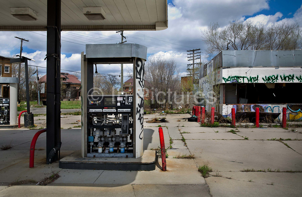 """Deserted petrol station on Grand River road near Downtown Detroit. Known as the world's traditional automotive center, """"Detroit"""" is a metonym for the American automobile industry and an important source of popular music legacies celebrated by the city's two familiar nicknames, the Motor City and Motown. Many neighborhoods remain distressed since the collapse of the motor industry. The state governor declared a financial emergency in March 2013, appointing an emergency manager. On July 18, 2013, Detroit filed the largest municipal bankruptcy case in U.S. history."""