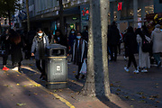 With local coronavirus lockdown measures in place and Birmingham currently set at 'Tier 2' or 'high', people, many of whom are wearing face masks walk along New Street in the city centre on 26th October 2020 in Birmingham, United Kingdom. The three tier system in the UK has levels: 'medium', which includes the rule of six, 'high', which will cover most areas under current restrictions; and 'very high' for those areas with particularly high case numbers. Meanwhile there have been calls by politicians for a 'circuit breaker' complete lockdown to be announced to help the growing spread of the Covid-19 virus.