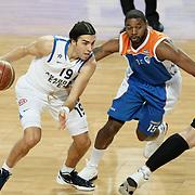 Anadolu Efes's Sasha Vujacıc (L) and Mersin BSB's Vincent Grier (R) during their Turkish Basketball League match Anadolu Efes between Mersin BSB at Sinan Erdem Arena in Istanbul, Turkey, Saturday, January 14, 2012. Photo by TURKPIX
