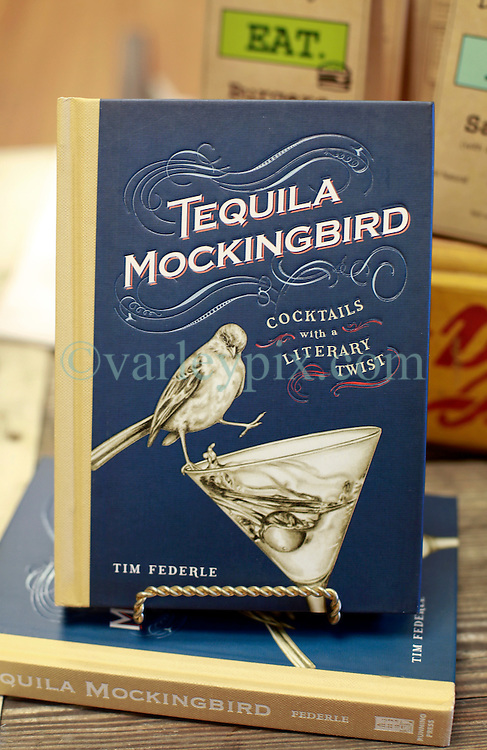 06 February 2015. Monroeville, Alabama.<br /> On the trail of Harper Lee's 'To Kill a Mocking Bird.'<br /> The cocktail book 'Tequila Mockingbird' at the old courthouse gift shop. The courtroom was used as the model for the Hollywood movie. The building is now the Monroe County Museum at the center of the old town. <br /> Photo; Charlie Varley/varleypix.com