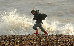© Licensed to London News Pictures. 24/10/2011. Felixstowe, UK. A young boy plays near waves. Windy weather along Felixstowe promenade today 24th October 2011. Parts of the UK are braced for wet and windy weather over the next 24hrs . Photo: Stephen Simpson/LNP
