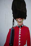 Poster of a Guard is defaced by a cigarette which looks like he is smoking, London, England, United Kingdom. The Guards Division is an administrative unit of the British Army responsible for the administration of the regiments of Foot Guards and the London Regiment. The Guards Division is responsible for providing two public duties battalions to London District although the guards are most associated with ceremonial, they are nevertheless operational infantry battalions, and as such perform all the various roles of infantry.
