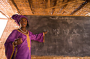 Female teacher giving math class at the Tangory Transgambienne 2 primary school in the town of Bignona, Senegal on Wednesday June 13, 2007.