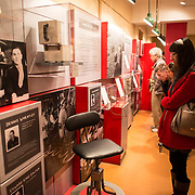 Visitors view exhibits at the Churchill Museum at the Churchill War Rooms in London. The museum, one of five branches of the Imerial War Museums, preserves the World War II underground command bunker used by British Prime Minister Winston Churchill. Its cramped quarters were constructed from a converting a storage basement in the Treasury Building in Whitehall, London. Being underground, and under an unusually sturdy building, the Cabinet War Rooms were afforded some protection from the bombs falling above during the Blitz.