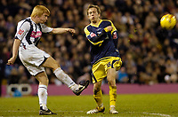 Photo: Leigh Quinnell.<br /> West Bromwich Albion v Derby County. Coca Cola Championship. 02/12/2006. West Broms Paul McShane clears the line ahead of Derbys Arturo Lupoli.