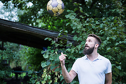 Young man playing football in garden, Bavaria, Germany