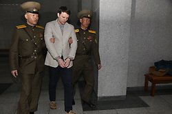 March 16, 2016 - Pyongyang, North Korea - American student OTTO FREDERICK WARMBIER (C) arrives for his trial in Pyongyang, capital of the Democratic People's Republic of Korea (DPRK). American student Otto Frederick Warmbier held by the Democratic People's Republic of Korea (DPRK) was sentenced to 15 years of hard labor for anti-DPRK crimes, the DPRK Supreme Court announced Wednesday. (Credit Image: © Guo Yina/Xinhua via ZUMA Wire)