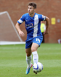 Peterborough United's Tommy Rowe  - Photo mandatory by-line: Joe Dent/JMP - Tel: Mobile: 07966 386802 17/08/2013 - SPORT - FOOTBALL - London Road Stadium - Peterborough -  Peterborough United V Oldham Athletic - Sky Bet League One