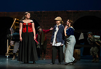 """Cecilia Zarella as Nancy, Kathryn Osburn as Oliver and Chelsea Sasserson at Bet during dress rehearsal for Gilford High School's musical """"Oliver"""" on Tuesday evening.   (Karen Bobotas/for the Laconia Daily Sun)"""