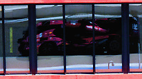 Shot at the open practice day held for the FIA World Endurance Championship Series at Circuit Paul Ricard in Le Castellete, France, this car is reflected in the Pit Suite windows as it leaves the pits to enter the track.
