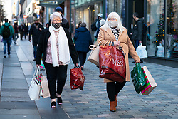 Glasgow, Scotland, UK. 19 November 2020. On the day before the highest level 4 lockdown is imposed on west and central Scotland, shops in Glasgow city centre and streets are busy with members of the public. Pictured; Female shoppers on Sauchiehall Street.   Iain Masterton/Alamy Live News