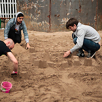 Sam Haine and the Bloodflames take some time out to build sandcastles at the Beached 2012 music festival, Castlefields, Manchester, 2012-06-02