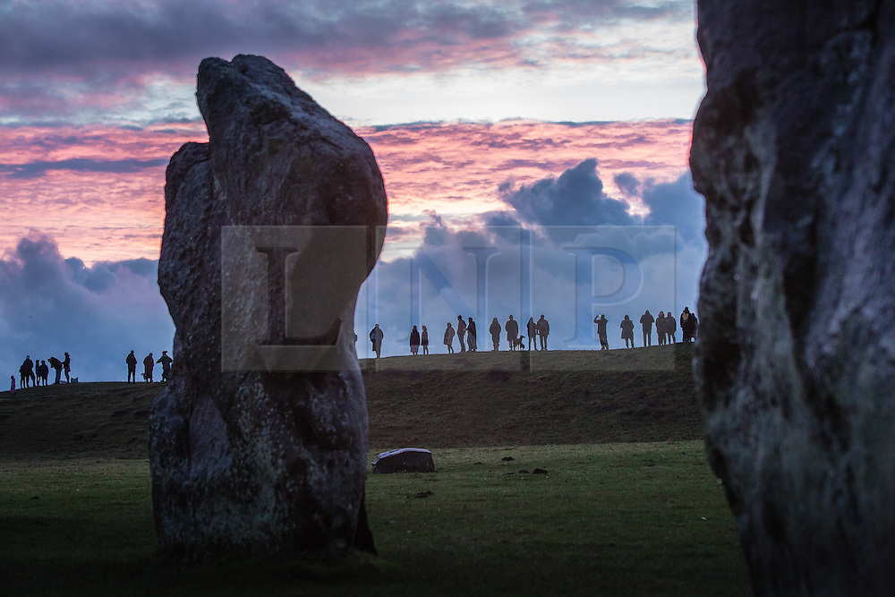© Licensed to London News Pictures 21/12/2016, Avebury,Wiltshire UK. Crowds gather to watch the sunrise on the winter  solstice, the shortest day of the year at Avebury Neolithic Stone Circle. Photo Credit : Stephen Shepherd/LNP