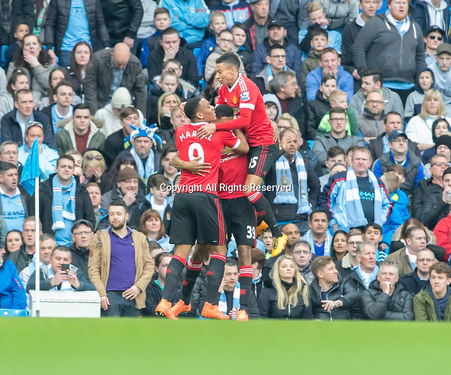 20.03.2016. Etihad Stadium, Manchester, England. Barclays Premier League. Manchester City versus Manchester United.  Manchester United striker Marcus Rashford celebrates with his team mates after scoring a goal in the 16th minute.