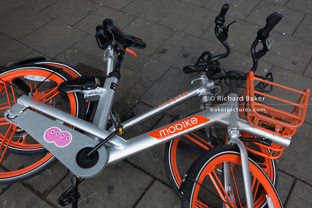 A potential trip hazard for passers-by as a pile of three abandoned dockless Mobikes are left in the street near Waterloo Station, on 4th March 2019, in London England.