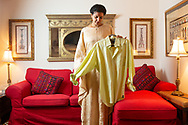 """CLIENT: THE WASHINGTON POST<br /> <br /> Hanan Elatr holds an item of clothing belonging to her late husband, journalist Jamal Khashoggi. The pair married only months before he was killed at the Saudi embassy in Turkey. <br /> <br /> <br /> Elatr is currently living at an undisclosed home in the Washington, D.C. area where she waits as her asylum case progresses because she fears for her safety. Her phone was targeted by Pegasus spyware, along with the devices of other journalists, activists and other surveillance interests. """"It makes me believe they are aware of everything that happened to Jamal through me,"""" Elatr said."""